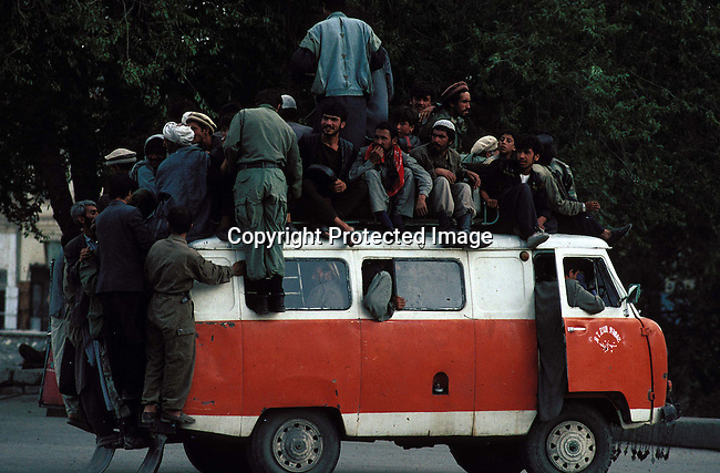 trgener16b Transport. General. Taxi. Road Safety. Overloading.  Men on roof of taxi. Afghanistan.  Bus to Kabut..©Per-Anders Petterson/iAfrika Photos