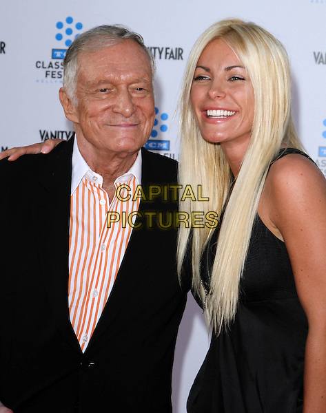 HUGH HEFNER & CRYSTAL HARRIS.2011 TCM Classic Film Festival Opening Night Held At The Grauman Chineses Theatre, Hollywood, California, USA..April 28th, 2011.half length couple fiance black dress suit jacket white orange stripe shirt smiling .CAP/ADM/KB.©Kevan Brooks/AdMedia/Capital Pictures.