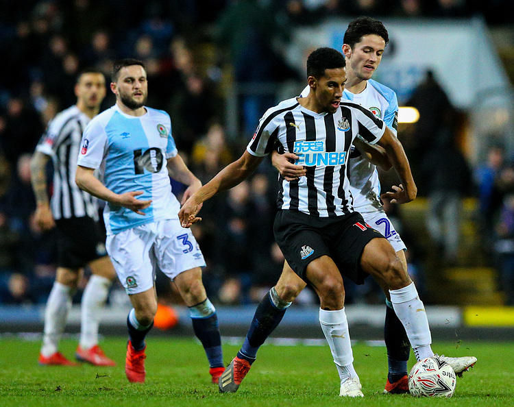 Newcastle United's Isaac Hayden holds off the challenge from Blackburn Rovers' Lewis Travis<br /> <br /> Photographer Alex Dodd/CameraSport<br /> <br /> Emirates FA Cup Third Round Replay - Blackburn Rovers v Newcastle United - Tuesday 15th January 2019 - Ewood Park - Blackburn<br />  <br /> World Copyright &copy; 2019 CameraSport. All rights reserved. 43 Linden Ave. Countesthorpe. Leicester. England. LE8 5PG - Tel: +44 (0) 116 277 4147 - admin@camerasport.com - www.camerasport.com