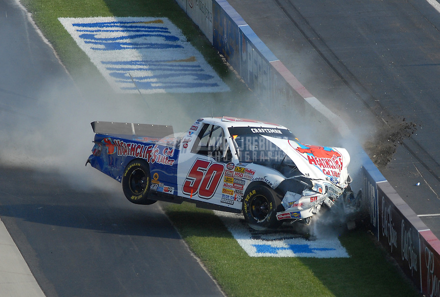 Jun 1, 2007; Dover, DE, USA; Nascar Craftsman Truck Series driver T.J. Bell (50) crashes during the AAA Insurance 200 at Dover International Speedway. Mandatory Credit: Mark J. Rebilas-US PRESSWIRE Copyright © 2007 Mark J. Rebilas...