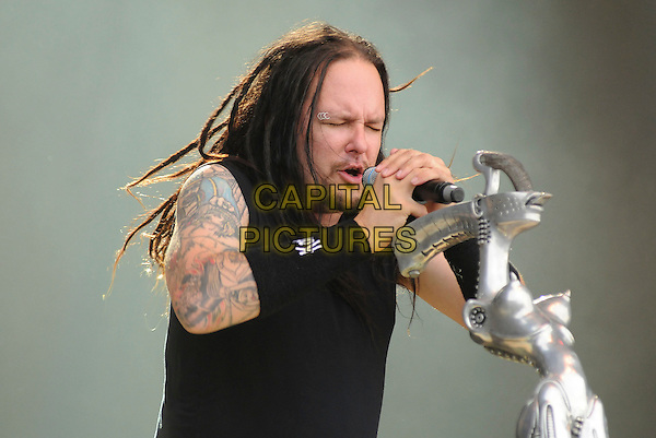 KORN - JONATHAN DAVIS .Download Festival 2009 - Day One,.Donington Park, Derbyshire, England,  UK, 12th June 2009..festival band gig on stage music live concert performing half length black microphone singing long hair jacket tattoos sleeveless eyes shut closed eyebrow piercing pierced rings wrist band .CAP/BRC.©Ben Rector/Capital Pictures