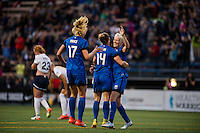 Seattle, Washington -  Sunday, September 11 2016: Seattle Reign FC midfielder Beverly Yanez (17) celebrates her with teammates after her goal during a regular season National Women's Soccer League (NWSL) match between the Seattle Reign FC and the Washington Spirit at Memorial Stadium. Seattle won 2-0.