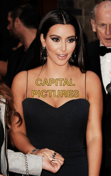 Kim Kardashian.The FiFi UK Fragrance Awards 2012 at The Brewery, Chiswell Street, London, England..May 17th 2012.half length dress blue black cleavage  hoop earrings .CAP/WIZ.© Wizard/Capital Pictures.