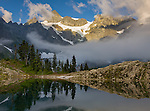 North Cascades National Park, WA<br /> Mt Shuksan with Curtis Glacier and swirling clouds reflecing on Lake Ann