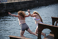 Saturday July 26th 2014 <br /> Pictured: Cardiff Bay <br /> RE: Two women in their underwear jump into the water at Cardiff Bay during the hot weather