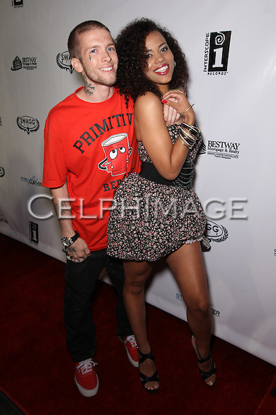 JEREME ROGERS, AMBER COSICH. Attendees to Souljah Boy Red Carpet Birthday Bash and Performance, sponsored by Swaggmedia.com, at the Highlands. Hollywood, CA, USA. July 28, 2010.