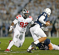 Ohio State Buckeyes defensive lineman Adolphus Washington (92) closes in on Penn State Nittany Lions quarterback Christian Hackenberg (14) during the 4th quarter of the NCAA Division I football game at Beaver Stadium in University Park, PA on October 25, 2014. (Columbus Dispatch photo by Jonathan Quilter)