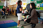 Michelle Rhee speaks with six-year-old Kylynn Mireles while touring PS7 in Sacramento, Calif., February 4, 2011.