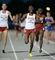 NWA Democrat-Gazette/ANDY SHUPE<br /> Arkansas' Gilbert Boit (center) celebrates Saturday, May 11, 2019, after passing Gilbert Kigen (right) of Alabama to win the 5,000 meters during the SEC Outdoor Track and Field Championships at John McDonnell Field in Fayetteville. Visit nwadg.com/photos to see more photographs from the meet.