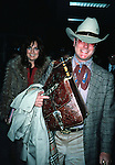 Larry Hagman and Linda Gray  ( DALLAS ).Arriving at Kennedy Airport,New York City. February 1982.