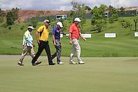 Padraig Harrington (IRL), James Morrison (ENG) and Daniel Chopra (SWE) finish their match on the 18th green during Sundays Final Round 3 of the 54 hole Iskandar Johor Open 2011 at the Horizon Hills Golf Resort Johor, Malaysia, 19th November 2011 (Photo Eoin Clarke/www.golffile.ie)