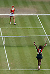 LONDON, ENGLAND - AUGUST 4:  Serena Williams of the USA celebrates her win against Maria Sharapova of Russia during the Women's Tennis Final, Day 8 of the London 2012 Olympic Games on August 4, 2012 at Wimbledon Tennis Club in London, England. (Photo by Donald Miralle)