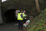 "Thomas ""Sav"" Cunningham and Paul Keegan clear up the Rubbish Dumped on Poorhouse Lane 4/1/12..Photo NEWSFILE/Jenny Matthews..(Photo credit should read Jenny Matthews/NEWSFILE)"