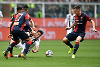 Ivan Radovanovic, Cristian Romero and Pedro Pereira of Genoa , Paulo Dybala of Juventus compete for the ball during the Serie A 2018/2019 football match between Genoa CFC and Juventus FC at stadio Luigi Ferraris, Genova, March 17, 2019 <br /> Photo Andrea Staccioli / Insidefoto