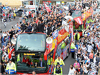 Swansea City FC SCFC, celebrate winning the championship playoffs and making it into the premier league with an open top bus ride through the streets of Swansea. 31/05/11