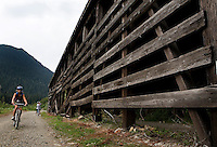 Photo by Stephen Brashear.Lorna Johnston of Bothell, Wash., rides past a snowshed on the John Wayn Pioneer Trail Hyak, Wash., and Rattlesnake Lake near North Bend, Wash., Sunday Aug. 17, 2008.