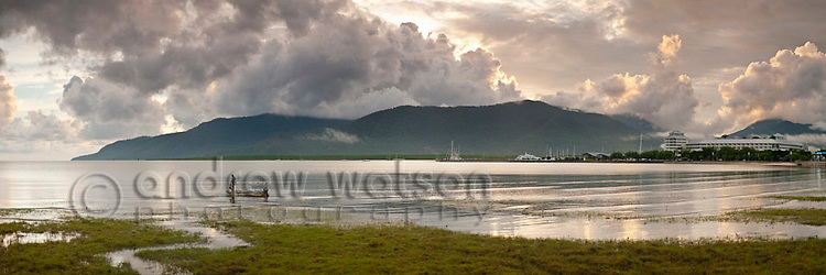 Fisherman on Esplanade at dawn.  Cairns, Queensland, Australia