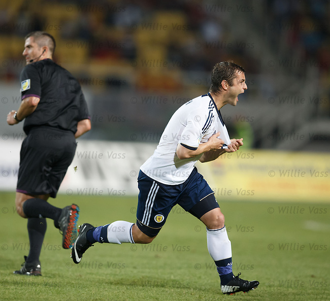 Shasun Maloney celebrates his winning goal for Scotland