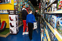 Pictured: Leroy Fer of Swansea City buying children gifts at Smyth's Toy Store, in Swansea, Wales, UK. Wednesday 19 December 2018