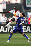 23 April 2009:  Matthew Mbuta (14) of the Red Bulls takes a shot on goal past defender Santiago Hirsig (10) of the Wizards.  The MLS Kansas City Wizards defeated the visiting New York Red Bulls 1-0 at Community America Ballpark in Kansas City, Kansas.