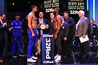 Joe Joyce (L) and Bryant Jennings during a Weigh In at the BT Studios, Queen Elizabeth Olympic Park on 12th July 2019