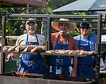 Greg Ranz, James Kirkland and Chad Kirkland prepare tri-tip and chicken for participants at the Microsoft 8th Annual Charity Golf Tournament held at Red Hawk Golf and Resort in Sparks on Friday, August 19, 2016.