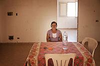 Palermo, Zen district unemployed homeless woman occupies together with other families empty houses in Zen neighborood.<br /> Palermo, quartiere Zen, disoccupata e senza casa occupa insieme ad altre famiglie abitazioni  in costruzione nel quartiere.