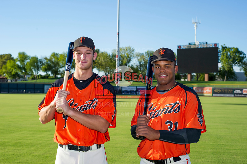 AZL Giants 2017 Draft Picks Jacob Gonzalez (52) and Heliot Ramos (31) pose for a photo prior to a game against the AZL Rangers on August 22 at Scottsdale Stadium in Scottsdale, Arizona. AZL Rangers defeated the AZL Giants 7-5. (Zachary Lucy/Four Seam Images via AP Images)