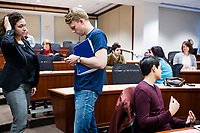 """Sam Carson, 28, (center), and Arianna Grand (left), 27, take care of last minute details before New York Assemblyman (79th District) and Vice Chair of the Democratic National Committee Michael Blake speaks to a live audience during a session of Resistance School in the Starr Auditorium in the Belfer Building of Harvard University's John F. Kennedy School of Government, on Thurs., April 27, 2017. Carson led the Resistance School logistics group volunteers before the lecture. Carson and Grand are Master in Public Policy grad students at the Kennedy School. Blake's lecture was titled """"How to sustain the resistance long term.""""  The lecture, which was the fourth such session and the final in what the group calls the """"first semester"""" of Resistance School, was also streamed live on the internet. Resistance School was started by progressive graduate students at Harvard after the Nov. 8, 2016, election of President Donald Trump. Resistance School describes itself as a """"practical training program that will sharpen the tools [needed] to fight back at the federal, state, and local levels."""" The live lectures are streamed and archived online alongside other information on the Resistance School website. During the lectures, teams of volunteers engage with followers on social media, including Facebook and twitter, sharing soundbytes, quotations, and supplementary materials as the lectures happen."""