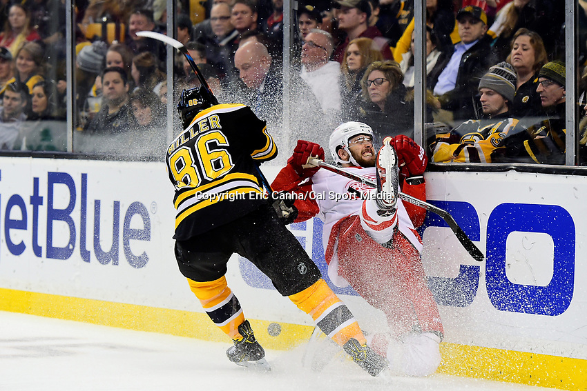 Tuesday, January 24, 2017: Boston Bruins defenseman Kevan Miller (86) checks Detroit Red Wings center Riley Sheahan (15) into the boards during the National Hockey League game between the Detroit Red Wings and the Boston Bruins held at TD Garden, in Boston, Mass. Boston defeats Detroit 4-3 in overtime. Eric Canha/CSM