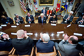 United States President Donald Trump makes remarks as he holds a listening session with American Labor leaders in the Roosevelt Room of the White House in Washington, DC on Monday, January 23, 2017.<br /> Credit: Ron Sachs / Pool via CNP