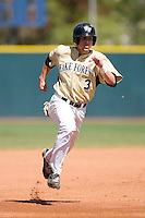 Tyler Smith #3 of the Wake Forest Demon Deacons hustles into third base at Jack Coombs Field March 29, 2009 in Durham, North Carolina. (Photo by Brian Westerholt / Four Seam Images)