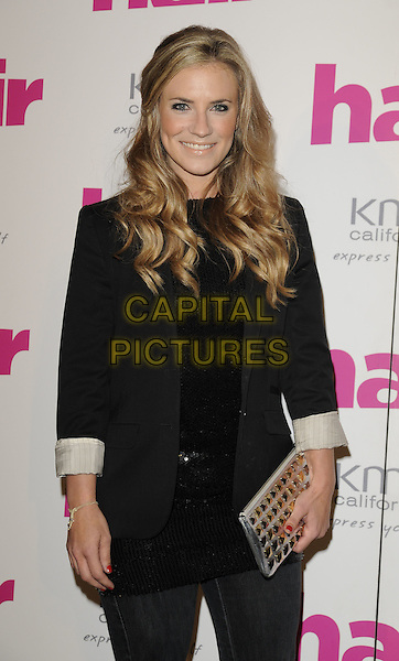 GEORGIE THOMPSON.The Hair Magazine Awards, Grosvenor Place, London, England. .September 29th, 2009 .half length jeans denim black blazer white cuffs gold clutch bag .CAP/CAN.©Can Nguyen/Capital Pictures.