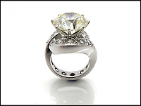 BNPS.co.uk (01202 558833)<br /> Pic: SheffieldAuctionGallery/BNPS<br /> <br /> ***Please use full byline***<br /> <br /> Single Stone Diamond Cocktail Ring<br /> <br /> A &pound;110,000 haul of jewellery seized from the ringleader of a &pound;26million tobacco smuggling operation is to go under the hammer.<br /> <br /> The collection includes a luxurious 9-carat diamond ring valued at &pound;40,000 and four jewel-encrusted designer wristwatches collectively worth &pound;30,000.<br /> <br /> Also among the 30 lots are an &pound;8,000 4.5 carat single stone ring, large 7-carat ear studs worth &pound;15,000 and a bizarre solid gold baby's dummy worth &pound;500.<br /> <br /> The items were confiscated from Daniel Harty, the mastermind of a criminal gang jailed for smuggling 150 million cigarettes and two tonnes of low quality tobacco into the UK.<br /> <br /> Harty created a distribution network around the north of England transporting cigarettes to warehouses, storage yards and farms.<br /> <br /> Between them they evaded paying &pound;26million of duty.<br /> <br /> Harty, 30, from Doncaster, Yorks, was jailed in June last year for four and a half years after pleading guilty to conspiracy to evade excise duty.<br /> <br /> The jewellery was seized from Harty on his arrest in early 2011 under the Proceeds of Crime Act. A judge ordered it should be sold to satisfy a &pound;330,000 confiscation order.<br /> <br /> The auction is being held at Sheffield Auction Gallery on March 21.