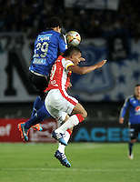 BOGOTA - COLOMBIA -14 -03-2015: Roman Torres (Izq.) jugador de Millonarios disputa el balón con Wilson Morelo (Der.) jugador de Independiente Santa Fe, durante partido entre Millonarios e Independiente Santa Fe por la fecha 10 de la Liga Aguila I-2015, jugado en el estadio Nemesio Camacho El Campin de la ciudad de Bogota. / Roman Torres (L) player of Millonarios vies for the ball with Wilson Morelo (R) player of Independiente Santa Fe, during a match between Millonarios and Independiente Santa Fe, for the  date 10 of the Liga Aguila I-2015 at the Nemesio Camacho El Campin Stadium in Bogota city, Photo: VizzorImage / Luis Ramirez / Staff.
