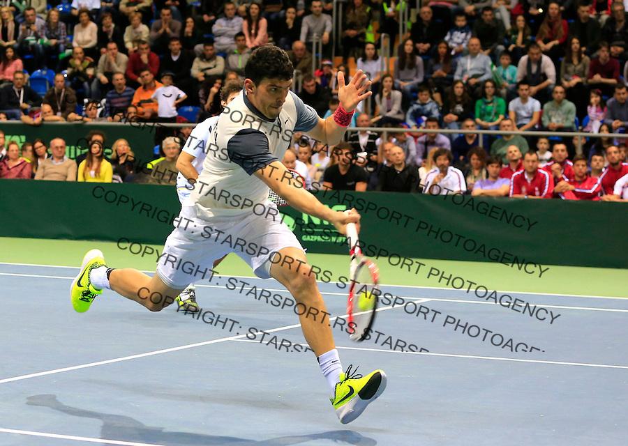 Davis Cup 2014 first round<br /> Srbija v Hrvatska<br /> Novak Djokovic and Nenad Zimonjic-Serbia v Franko Skugor and Marin Draganja doubles dublovi<br /> Franko Skugor in action<br /> Kraljevo, 07.03.2015.<br /> Foto: Srdjan Stevanovic/Starsportphoto.com&copy;