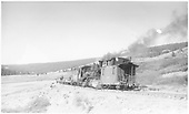 K-27 #461 with caboose #0400 and flat cars in Lizard Head Pass?<br /> RGS  Lizard Head ?, CO  Taken by Perry, Otto C.