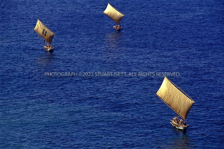 Lamalera, Indonesia..Whaling boats return to Lamalera after a day at sea...Photograph by Stuart Isett.©2003 Stuart Isett