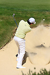 Rory McIlroy chips out of the bunker at the 5th green during Round 3 of the BMW PGA Championship at  Wentworth, Surrey, England, 22nd May 2010...Photo Golffile/Eoin Clarke.(Photo credit should read Eoin Clarke www.golffile.ie)....This Picture has been sent you under the condtions enclosed by:.Newsfile Ltd..The Studio,.Millmount Abbey,.Drogheda,.Co Meath..Ireland..Tel: +353(0)41-9871240.Fax: +353(0)41-9871260.GSM: +353(0)86-2500958.email: pictures@newsfile.ie.www.newsfile.ie.