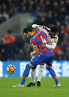 Crystal Palace's Luka Milivojevic battles with Burnley's Georges-Kevin Nkoudou<br /> <br /> Photographer Ashley Crowden/CameraSport<br /> <br /> The Premier League - Crystal Palace v Burnley - Saturday 13th January 2018 - Selhurst Park - London<br /> <br /> World Copyright &copy; 2018 CameraSport. All rights reserved. 43 Linden Ave. Countesthorpe. Leicester. England. LE8 5PG - Tel: +44 (0) 116 277 4147 - admin@camerasport.com - www.camerasport.com