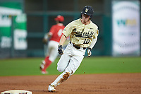 Ethan Paul (10) of the Vanderbilt Commodores rounds third base against the Houston Cougars during game nine of the 2018 Shriners Hospitals for Children College Classic at Minute Maid Park on March 3, 2018 in Houston, Texas. The Commodores defeated the Cougars 9-4. (Brian Westerholt/Four Seam Images)