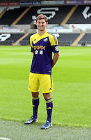 Pictured: Player Ben Davies wearing the away kit, at the official launch of the 2013-2014 Swansea City Football Club kit launch at the Liberty Stadium, Swansea, south Wales. Friday 28th of June 2013