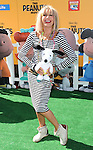 Betsy Johnson with her Snoopy toy at The Peanuts Movie premiere held at the Regency Village Theaters Los Angeles, CA. November 1, 2015