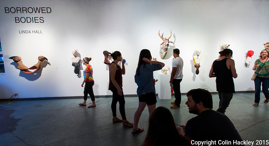 Artist Linda Hall's &quot;Borrowed Bodies&quot; exhibit draws a crowd at the 621 Gallery in Tallahassee's Railroad Square Art Park. <br /> <br /> COLIN HACKLEY PHOTO