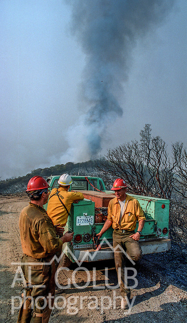 August 3, 1992 Big Oak Flat, California -- Moccasin Fire – Stanislaus Hotshots get ready to pack up after working all night in burning operations to protect the community of Big Oak Flat.  The fire spread quickly from near Moccasin Reservoir up the New Priest Grade on Highway 120 to the community of Big Oak Flat. The Moccasin Fire consumed nearly 5,000 acres.
