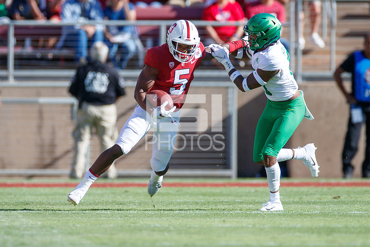 STANFORD, CA - SEPTEMBER 21: Connor Wedington #5 of the Stanford Cardinal avoids a tackle by Jevon Holland #8 of the Oregon Ducks during a game between University of Oregon and Stanford Football at Stanford Stadium on September 21, 2019 in Stanford, California.