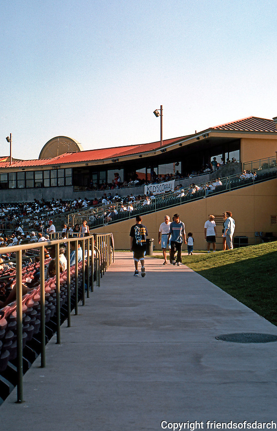 """Ballparks: San Bernardino """"The Ranch""""--left field aisle. To the left, seats; right, a grassy knoll; an awninged terrace of tables above."""