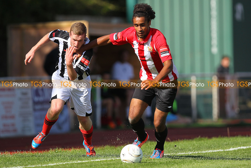 Stefan Payne (R) of AFC Hornchurch seeks to evade Tom Stephen of East Thurrock - AFC Hornchurch vs East Thurrock United - Ryman League Premier Division Football on Non-League Day at The Stadium, Upminster Bridge, Essex - 07/09/13 - MANDATORY CREDIT: Gavin Ellis/TGSPHOTO - Self billing applies where appropriate - 0845 094 6026 - contact@tgsphoto.co.uk - NO UNPAID USE