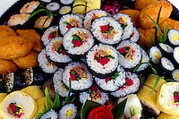 Colorful close-up of a large platter of various sushi at Fukuya restaurant in Honolulu.