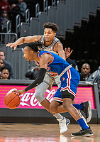 WASHINGTON, DC - DECEMBER 28: Jagan Mosely #4 of Georgetown moves in on Stacy Beckton JR. #2 of American. during a game between American University and Georgetown University at Capital One Arena on December 28, 2019 in Washington, DC.